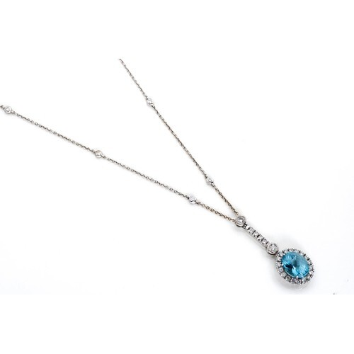 AN AQUAMARINE AND DIAMOND PENDANT NECKLACE, BROWNS