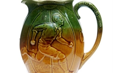 An early 20th Century water jug decorated with a relief moul...