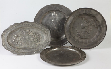 FOUR 17TH-19TH CENTURY ENGLISH AND CONTINENTAL PEWTER CHARGERS AND PLATTERS....