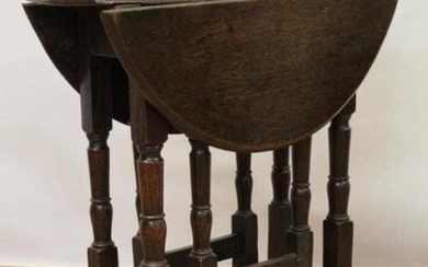 Small late 17th / early 18th century oak gateleg table on turned supports joined by stretchers on scroll feet