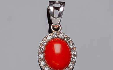 White gold pendant with oval coral cabochon and border...