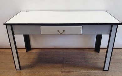 A 1920s white and black enamel table, with a single drawer, ...