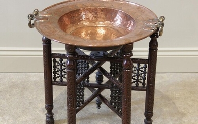 A 19th century copper brazier bowl, applied with brass side ...