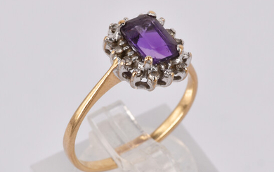 A 9CT GOLD DIAMOND AND AMETHYST RING