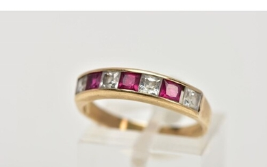 A 9CT GOLD HALF ETERNITY RING, designed with a row of channe...