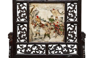 A Chinese marble set hardwood table screen, late Qing dynasty, the marble panel painted to one side with an official and attendants travelling in a landscape and inscribed with calligraphy to the reverse, the framed carved and pierced with chilong...