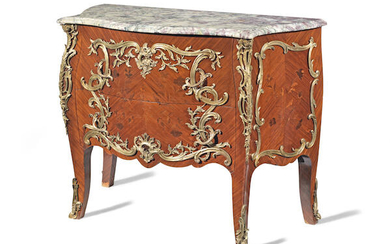 A French late 19th century ormolu mounted kingwood, bois satine and 'bois de bout' (end-cut) marquetry serpentine commode
