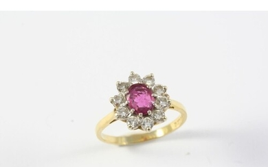 A PINK SAPPHIRE AND DIAMOND CLUSTER RING the oval-shaped pin...