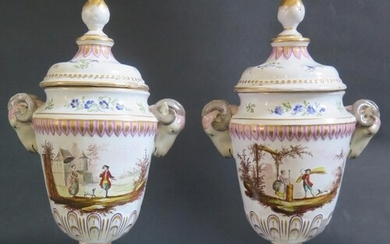 A Pair of Veuve Perrin Faience Rams Vases with ram's mask ha...