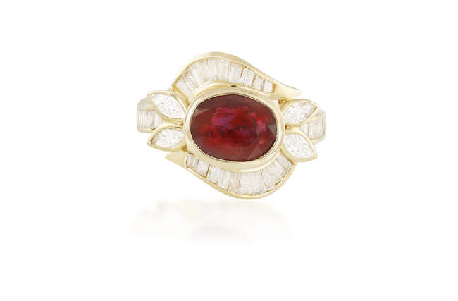 A RUBY AND DIAMOND DRESS RING The central...