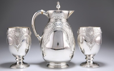 A VICTORIAN SILVER JUG AND PAIR OF GOBLETS, by