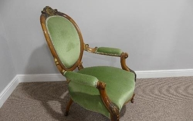 A Victorian walnut showframe open Armchair, with gilt carved...