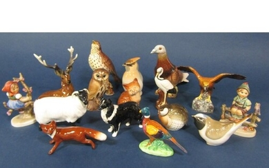 A collection of Beswick and other model animals and birds in...