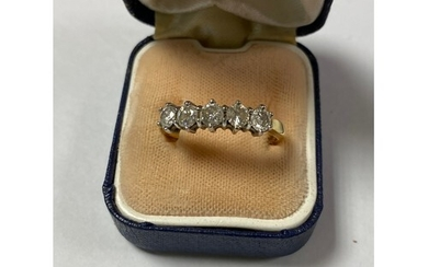 A diamond five stone ring, composed of five diamond claw set...