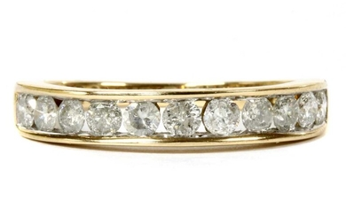 A gold diamond half eternity ring