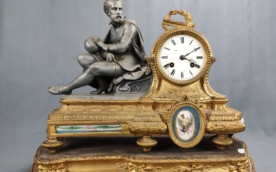 A mantel clock / table clock with cosmograph, seated scholar with compass and globe, on the right r