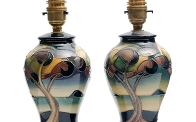 A pair of Moorcroft Pottery table lamp bases decorated in th...