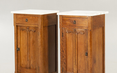 A pair of oak and marble bedside tables early 1900s