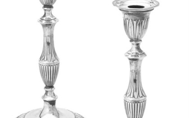 A pair of silver candlesticks by Goldsmiths & Silversmiths Co. Ltd.