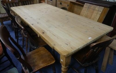 A vintage stripped pine Kitchen Table, with two frieze drawe...