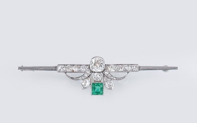 An Art Nouveau Brooch with Diamonds and Emeralds.
