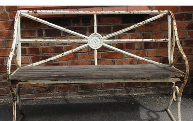 An early 19th century painted iron garden bench, the rail ba...