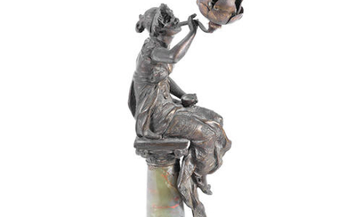 An early 20th century French bronzed spelter and onyx figural lamp
