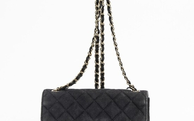 """NOT SOLD. Chanel: A """"Mini Rectangular Flap Bag"""" of black quilted suede with gold tone hardware, chain strap and one exterior back pocket. – Bruun Rasmussen Auctioneers of Fine Art"""