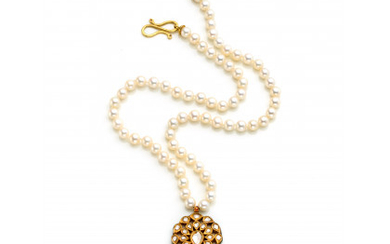 Cultured pearl necklace with an indian style yellow gold central pendant with flat diamonds, enamels and an emerald bead pendant…Read more