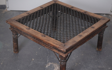 Indian low table in partially carved wood, 20th Century.