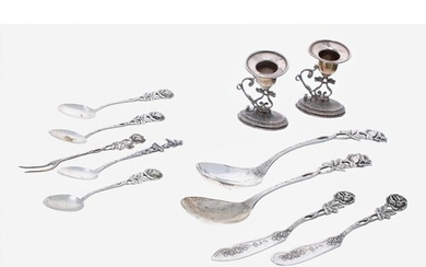 Pair of German 800 silver dessert spoons, with pierced rose ...