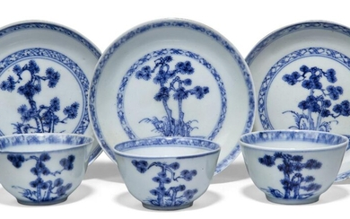 Three pairs of Chinese porcelain blue and white 'pine' teabowls and saucers excavated from the Nanking Cargo, circa 1750, painted with pine trees amongst rockwork, 6.2cm-10cm diameter (6) Provenance: with Christie's Nanking Cargo paper labels to...