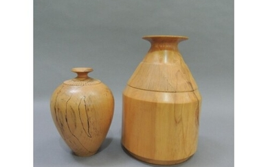 Two spalted beech turned vases, of ovoid form with fluted co...