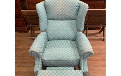 Upholstered wingback, reclining armchair.
