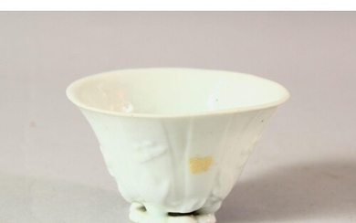 A CHINESE BLANC DE CHINE PORCELAIN LIBATION CUP, with moulde...