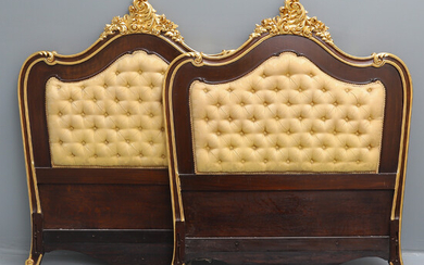 A PAIR OF REPRODUCTION LOUIS XV STYLE MAHOGANY AND CARVED GILT-WOOD HEADBOARDS.