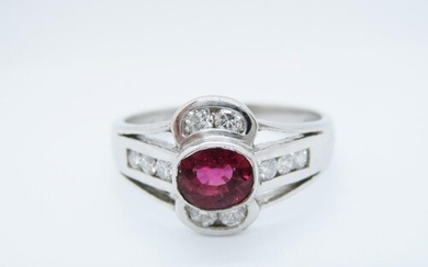 A Ruby and Diamond Ring rubover-set oval-cut ruby within cha...