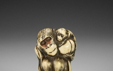 A STAG ANTLER NETSUKE OF A MONKEY