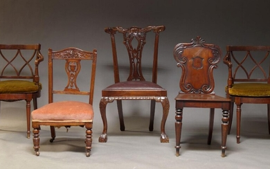 A Victorian mahogany hall chair, the backrest with carved scrolling foliate motifs, centred by a vacant cartouche, on front turned and tapering legs, together with pair of mahogany and caned armchairs, an Edwardian nursing chair and a Chippendale...