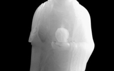 A WHITE JADE FIGURE OF A STANDING BUDDHA- Qing...