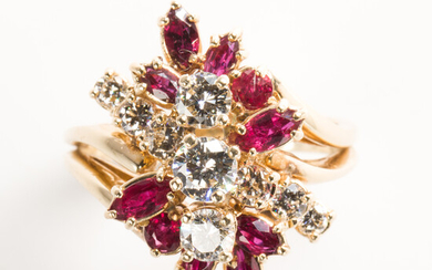A diamond, ruby and fourteen karat gold ring