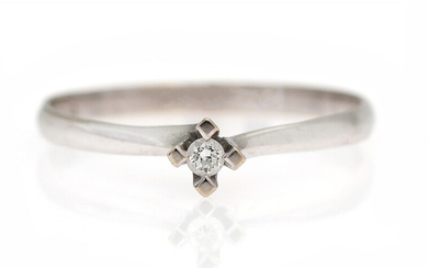 A diamond solitaire ring set with a brilliant-cut diamond, mounted in 14k white gold. Size...