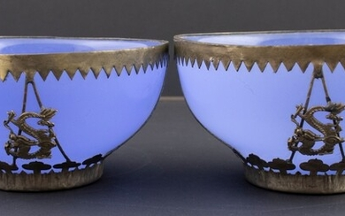 A pair of Chinese glass dishes with plated copper mounts,...