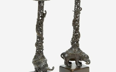 """A pair of Japanese """"Elephant and Dragon"""" candlesticks"""