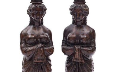 A pair of carved wooden figure head style candle stands:, ea...