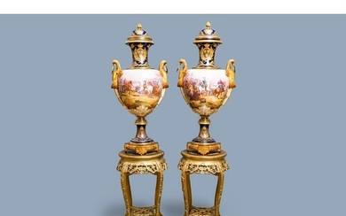 A pair of massive French Sèvres-style vases with gilded bron...