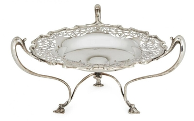 A pierced Edwardian silver tazza, London, c.1908, Goldsmiths & Silversmiths Co., designed with three bifurcated handles to trefoil pad feet, the shaped rim to pierced edge and plain base with concave centre, 17cm high, 30cm dia. (to handles)...