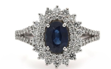 A sapphire ring set with a sapphire weighing app. 1.08 ct. encircled by diamonds, mounted in 18k white gold. Size app. 54. – Bruun Rasmussen Auctioneers of Fine Art