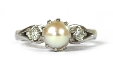 A white gold three stone cultured pearl and diamond ring