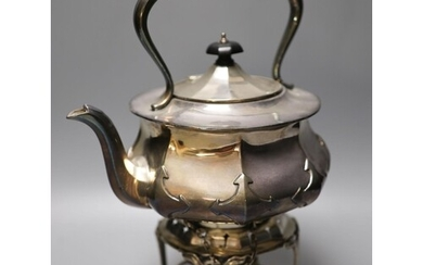 An Edwardian silver tea kettle on stand, with plated burner,...